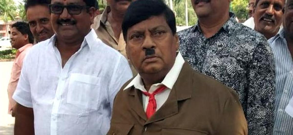 TDP leader dons Hitlers look to protest over special status for AP