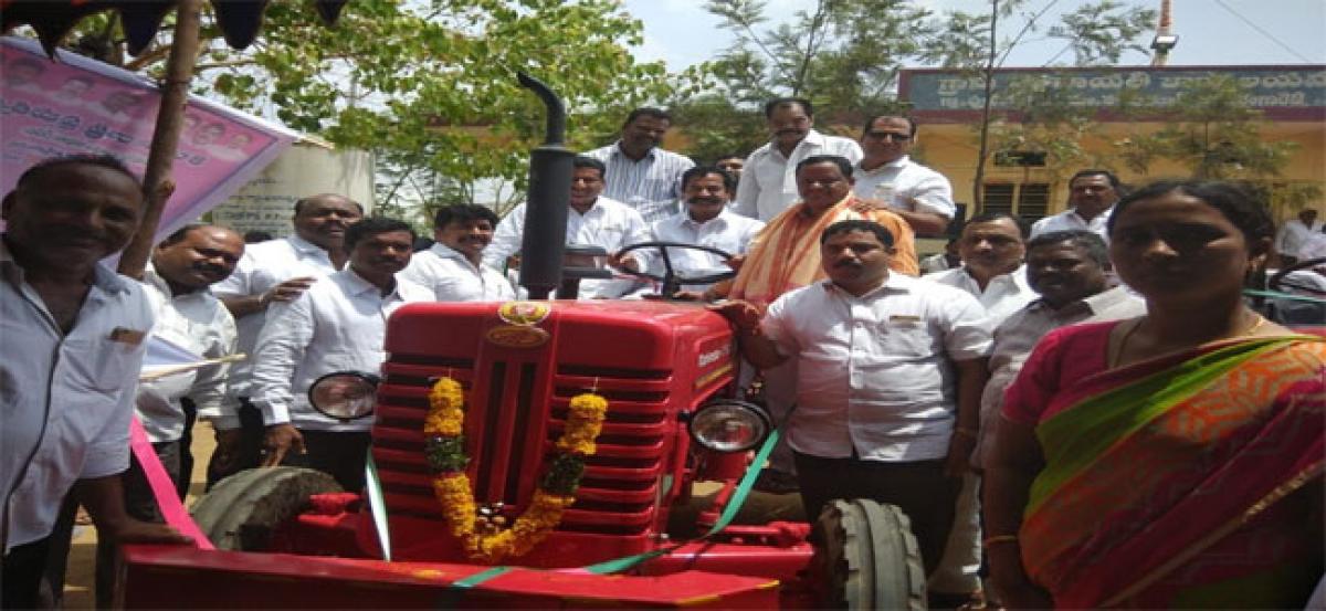 MLA Teegala distributes cows, tractors