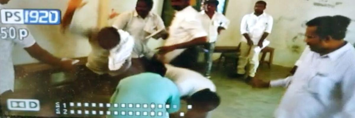 TRS workers thrash polling official in Huzurnagar constituency