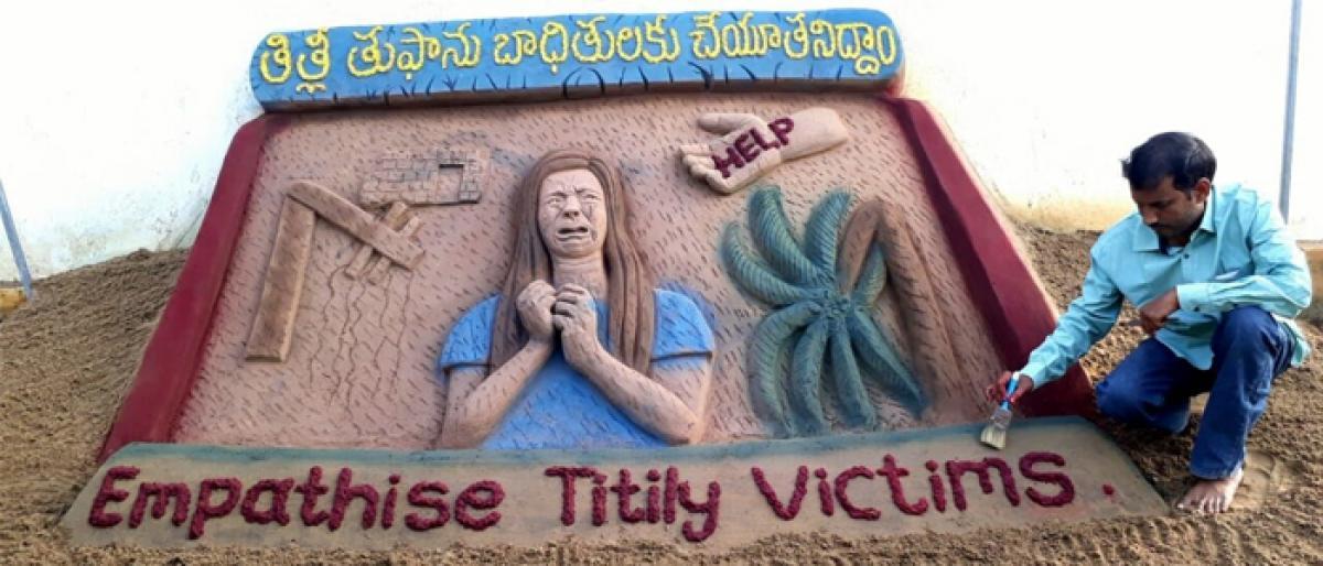 Sand sculpture seeking aid for Titli victims