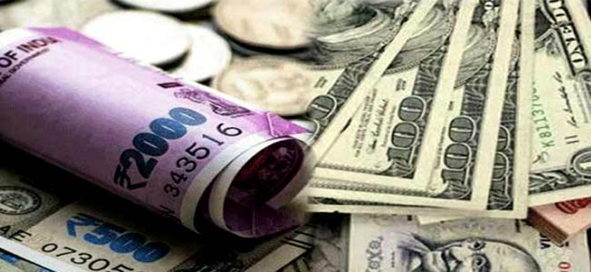 Rupee skids 23 paise to 73.68 against US dollar