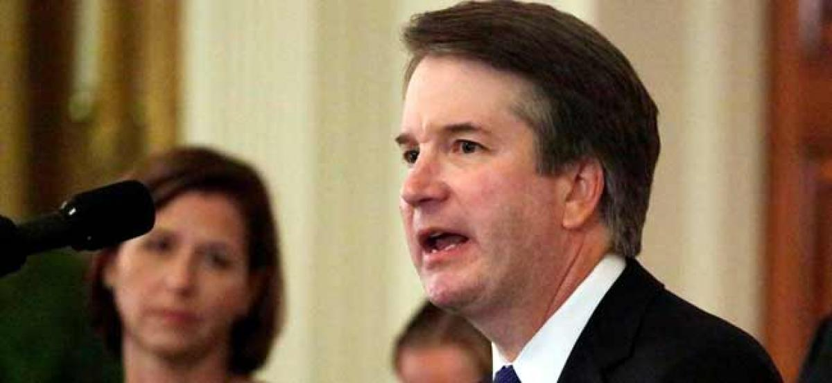 Brett Kavanaugh sworn in as Supreme Court Judge amidst widespread outcry over sexual assault allegations