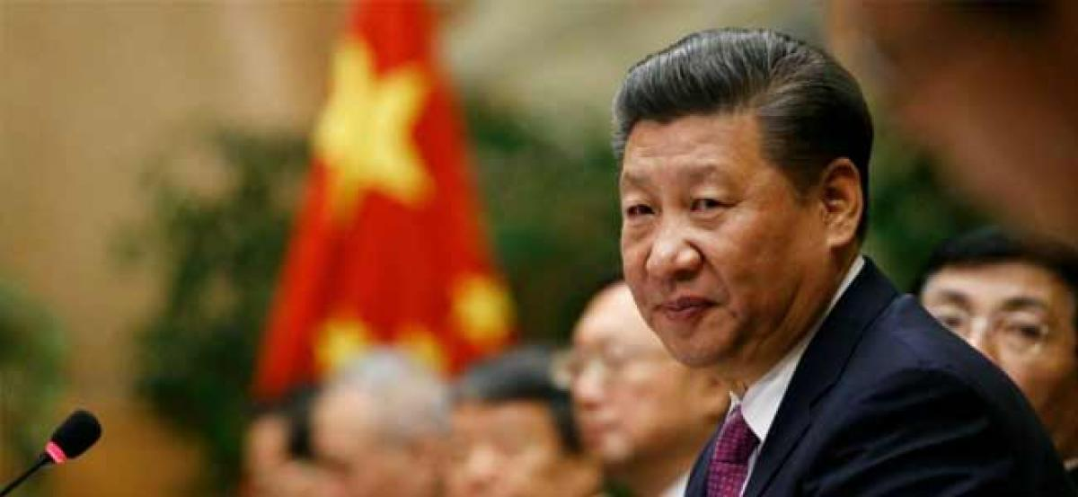 President Xi Jinping urges international community to oppose protectionism