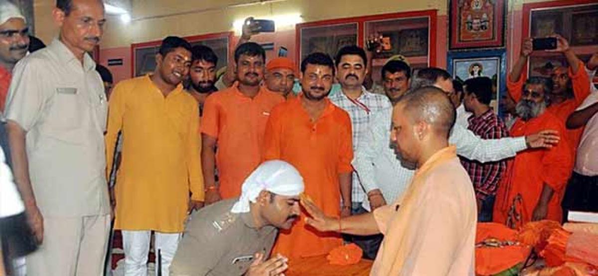 In Gorakhpur, cop in uniform kneels down before CM Adityanath to seek blessings