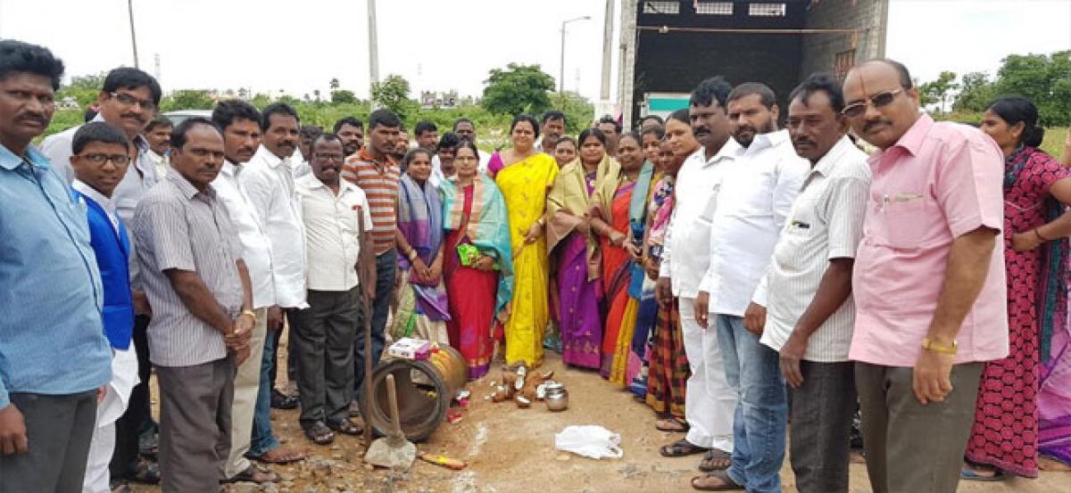 Lakshmi Prasanna lays foundation for underground drainage works