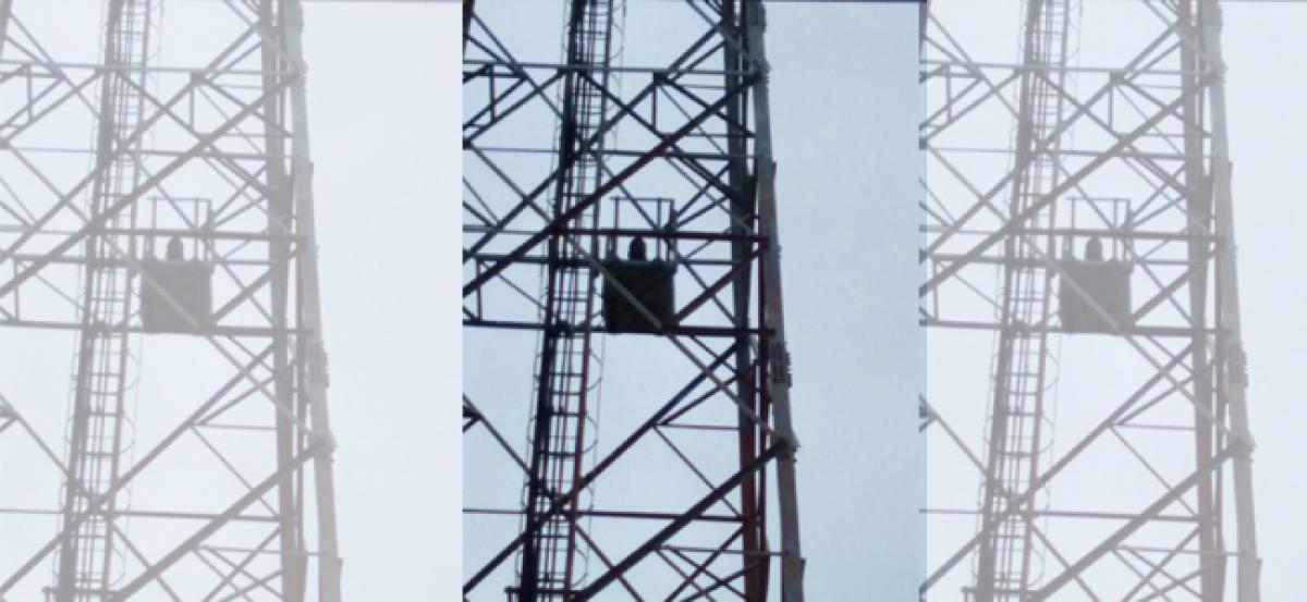 Gritty girl continues fight, climbs cell tower in Bhongir