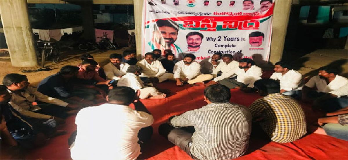 Citizens spend night at incomplete community hall, demand its completion