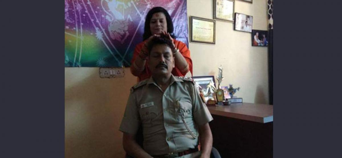 Cop transferred after picture with god woman goes viral