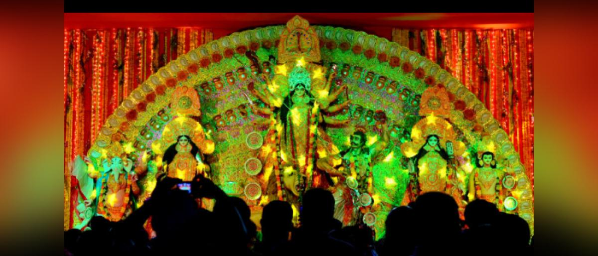 Green themes abound in Durga Puja marquees