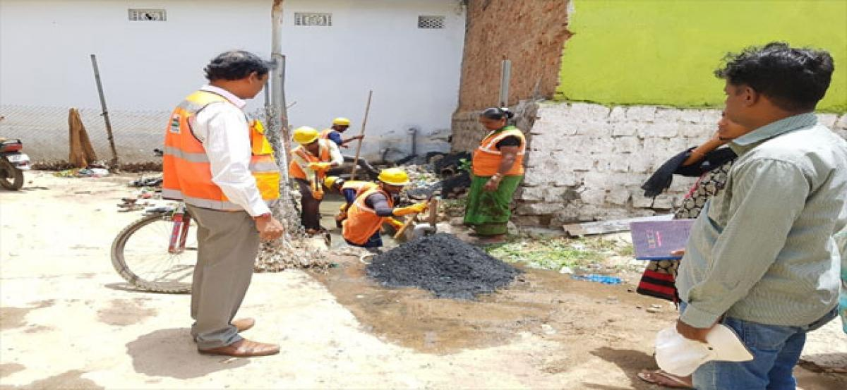 GHMC workers start restoration works of drainage system