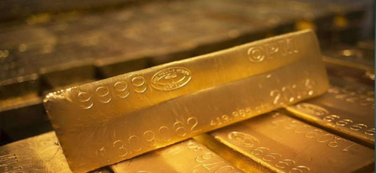 Gold slumps on muted demand, global cues