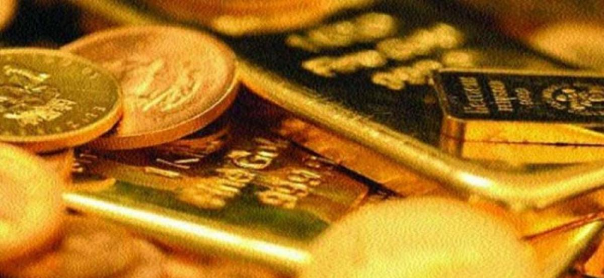 Gold remains weak on global cues, muted demand