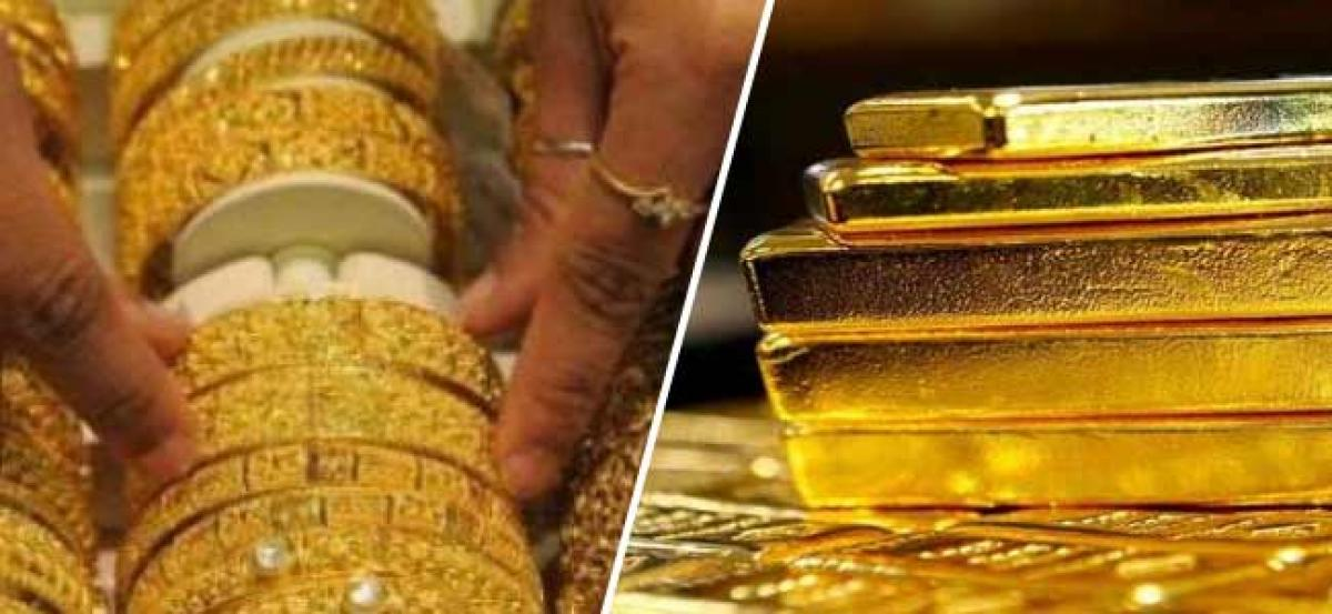 Gold prices subdued on global cues, low demand