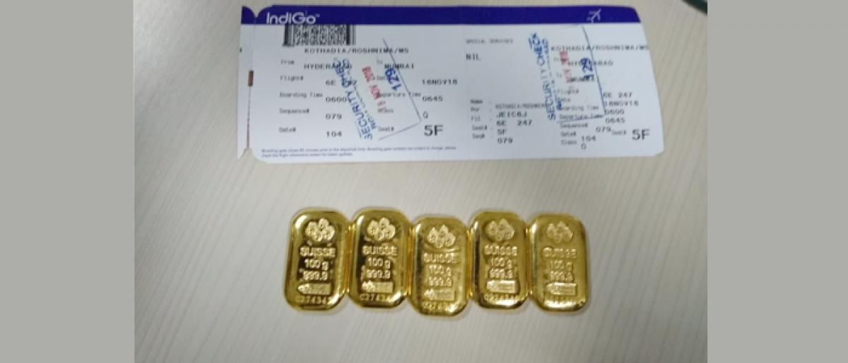 Customs officials seized Rs 15 lakh gold biscuits in Shamshabad Airport