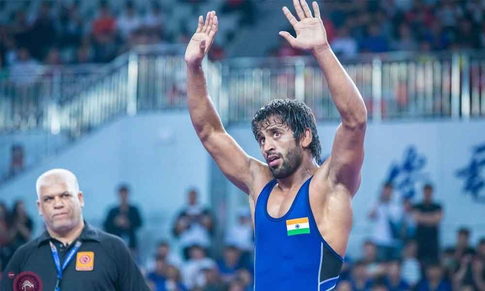 Bajrang, Ravi seal place in Indias