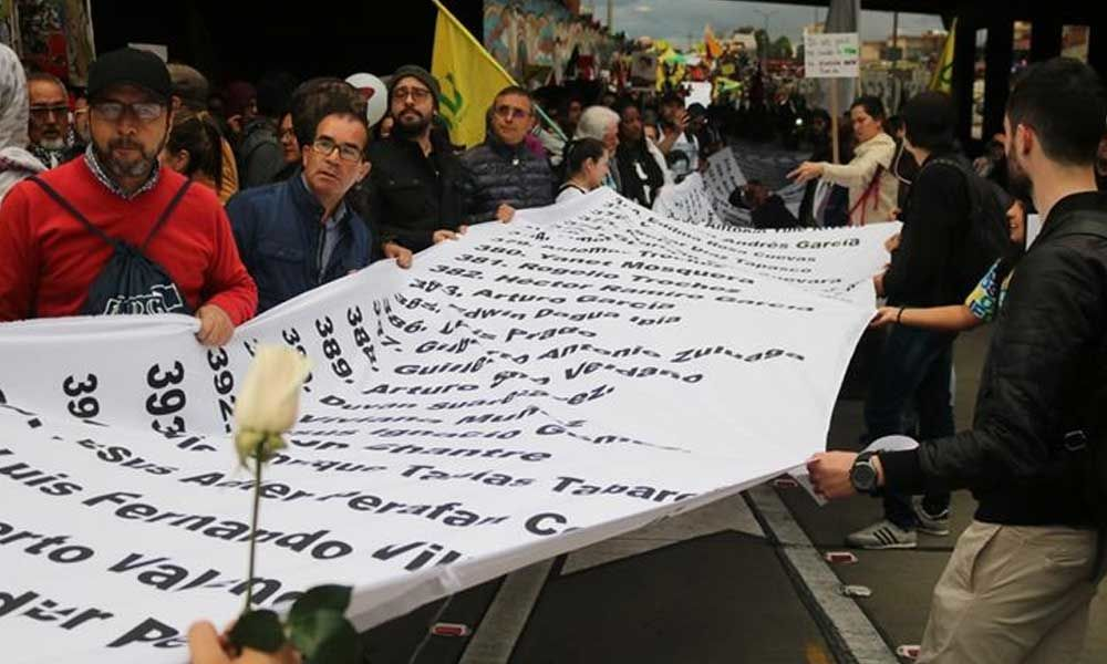 Thousands protest in Colombia against killings of activists