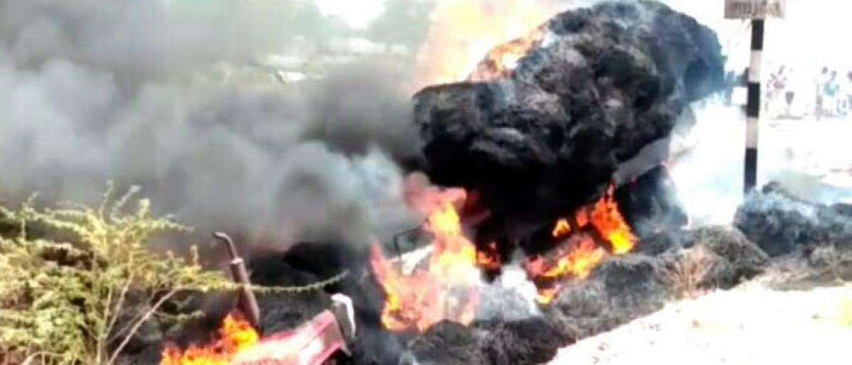 Haystack-laden tractor reduced to ashes