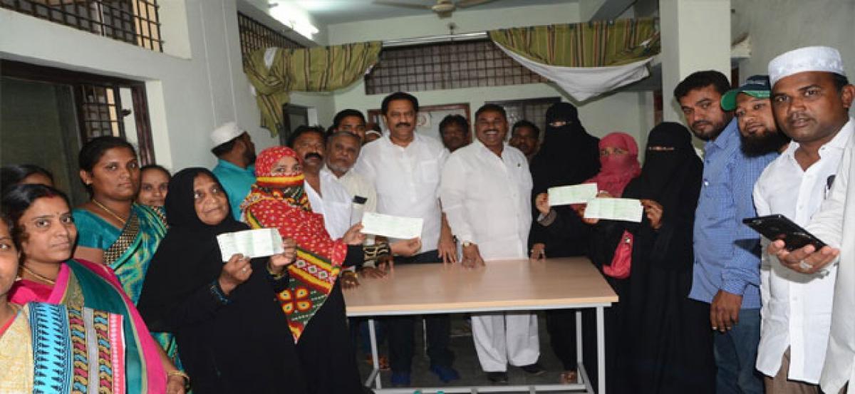 Maganti hands over Shaadi Mubarak and Kalyana Lakshmi cheques