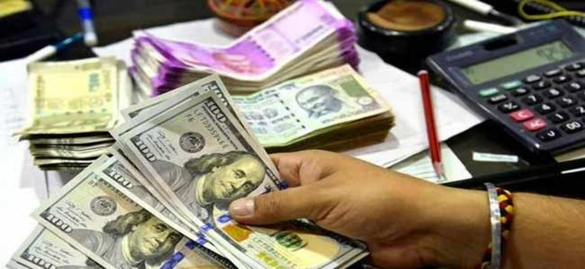 Rupee drops an inch at Mumbai foreign exchange market