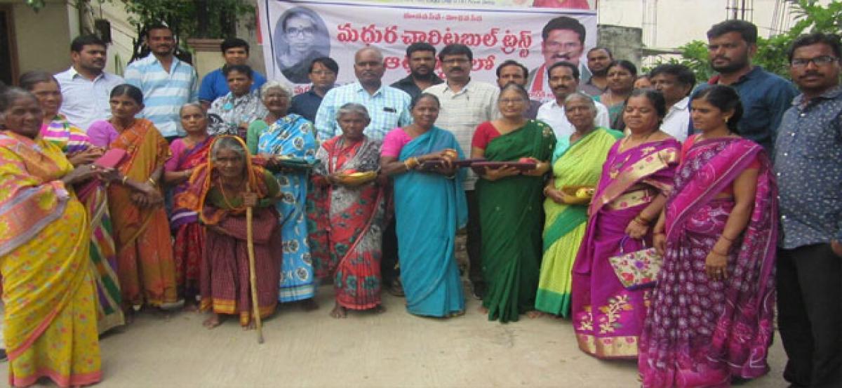 Ragidi Lakshma Reddy distributes medicines to elders