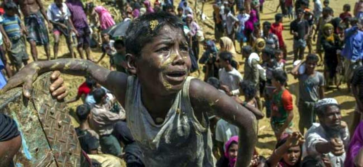 Suu Kyi says handling of Rohingya could have been better