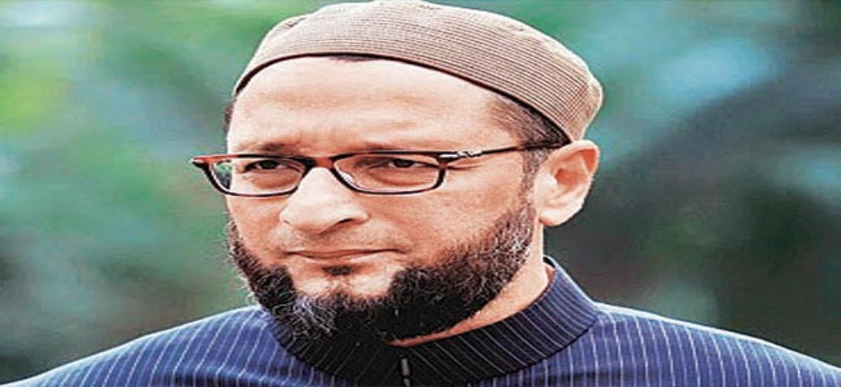 Arrest those who threatened Malayalam author: Owaisi