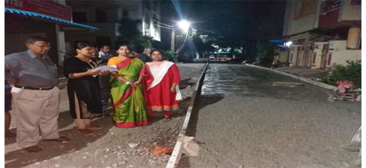 Corporator Padmavathi inspects laying of CC roads