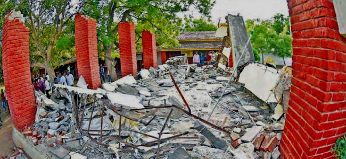 School roof collapse kills two students, leaves five others injured