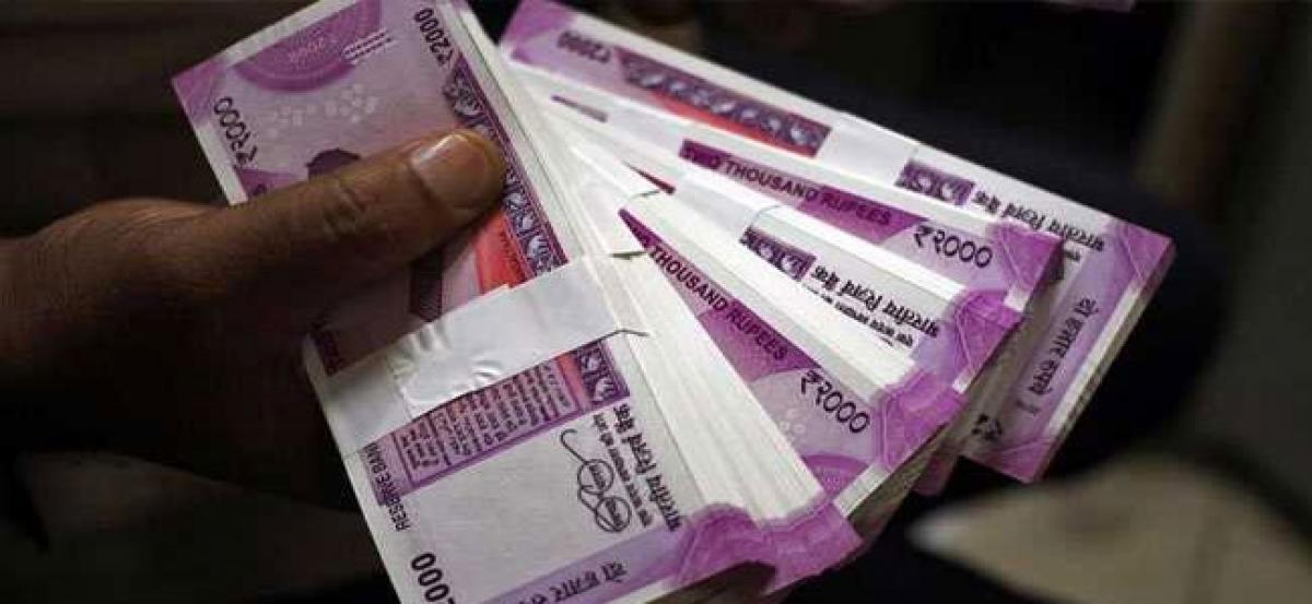 Rupee flat against US dollar ahead of RBI monetary policy