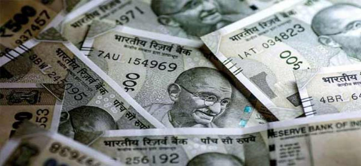 Rupee rises from record low, recovers 23 paise against US dollar
