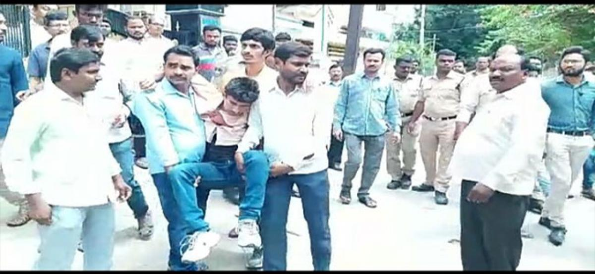 Parents thrash teacher for misbehaving with girls in Amaberpet