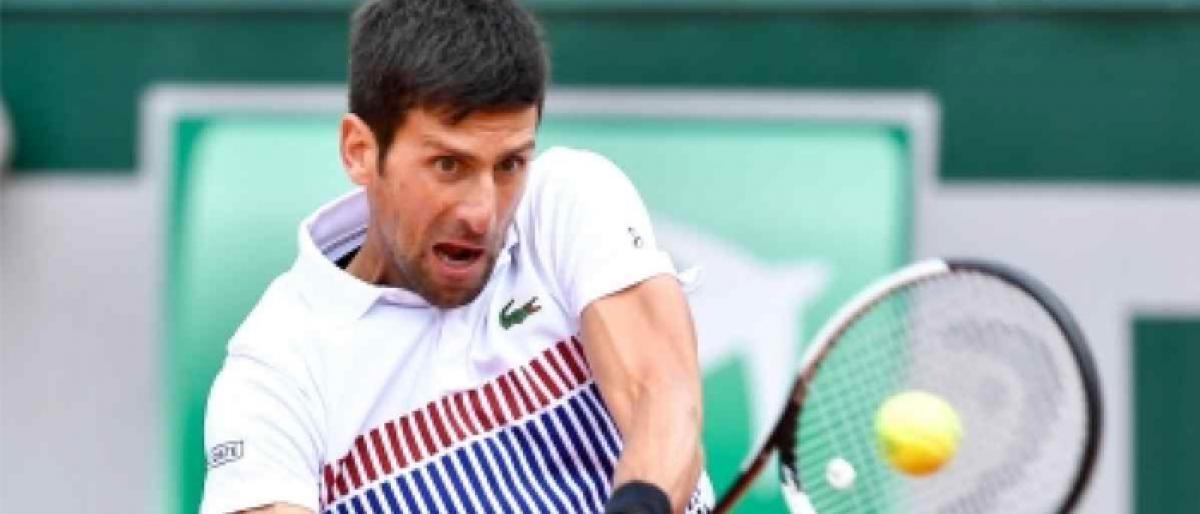 Djokovic defeats Federer in Paris Masters thriller