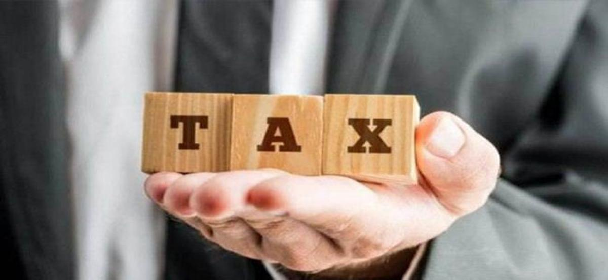 Govt may tweak tax slabs, bring standard deduction: EY Survey