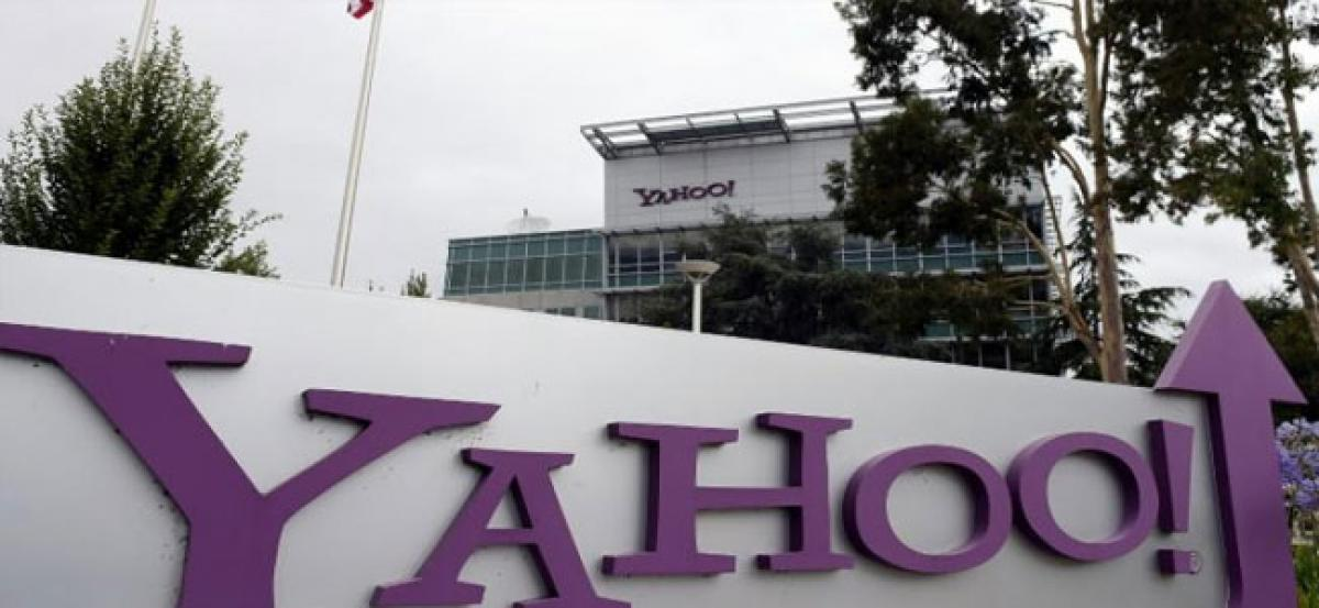 Yahoo buys back USD 2 bn of shares in three-way deal with SoftBank